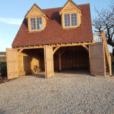 Either open-fronted cart lodges or secure garages, oak framed structures make exceptionally attractive shelters for your car. Built to your specification with the option of useful space above, you could combine its use to include a games room or guest accommodation. The choice is yours.