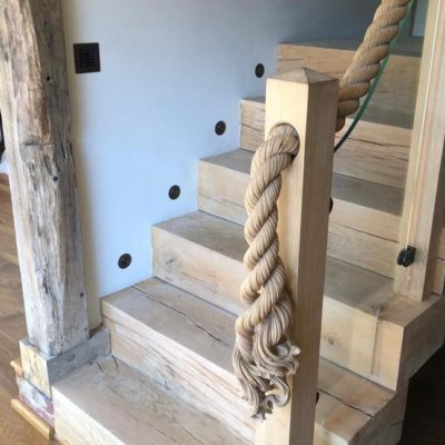 Whether you are looking for an oak staircase, windows, doors or built-in furniture, we have one of the finest teams of joiners in the country. Take a close look at this beautiful oak baulk staircase and see if you can spot the mouse peeping out at the bottom of the hand carved rope.
